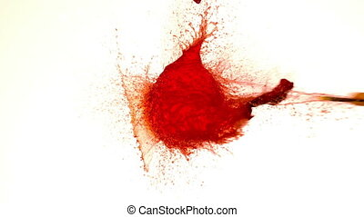 Arrow shooting through water balloon on white background in...