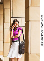 young businesswoman on the phone - portrait of young adult...