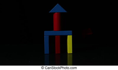 Building block tower falling over in slow motion