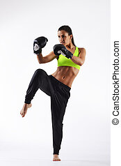 beautiful fitness woman with the black boxing gloves
