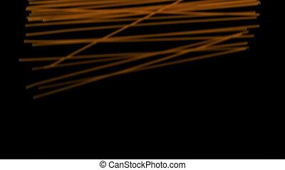 Spaghetti pouring onto black surfac