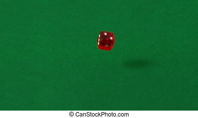 Red dice falling and bouncing in slow motion