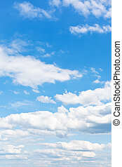 many white puffy clouds in blue sky