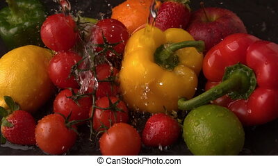 Water raining on selection of fresh produce - Water raining...