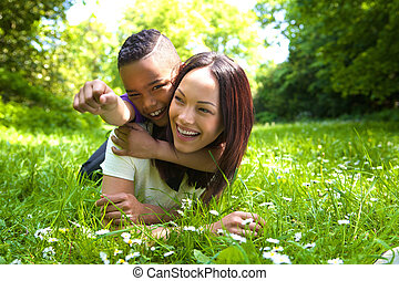 Young mother laughing with her son outdoors - Close up...