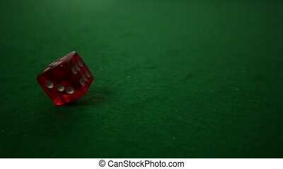 Red dice spinning on casino table