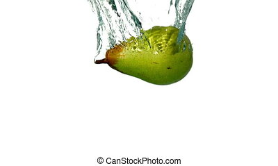 Pear plunging into water on white background in slow motion