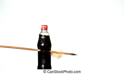 Arrow shooting through plastic bottle in slow motion