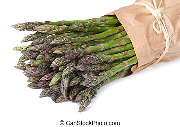 Fresh asparagus shoots in paper packing isolated