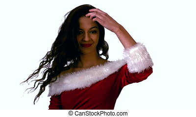 Pretty brunette in santa outfit tossing her hair in slow...