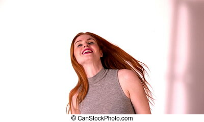 Pretty redhead tossing her long hair in slow motion