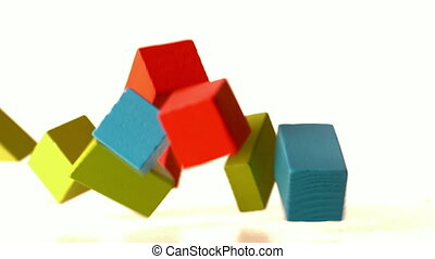 Many building blocks falling and bouncing in slow motion