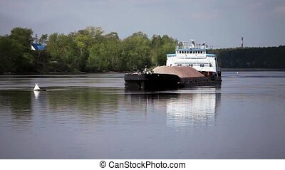 Barge with sand zoom - Barge with sand reflection in the...