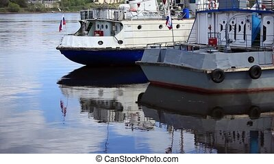 Moored River ships at the pier reflection