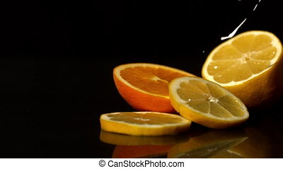 Whipped cream pouring onto orange slices in slow motion