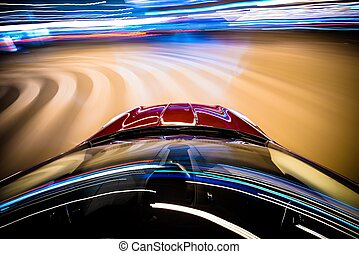 Speeding Car. Car in Motion. Blurred City Lights on Curved...