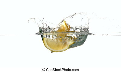 Lemon segments plunging into water
