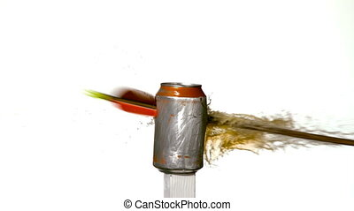 Arrow shooting through soda can on white background in slow...