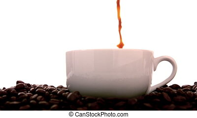 Hot coffee pouring into white cup
