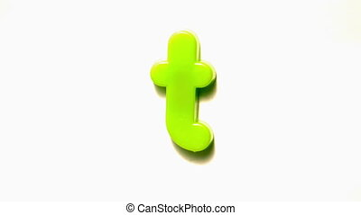 Green letter t lifting off white background in slow motion