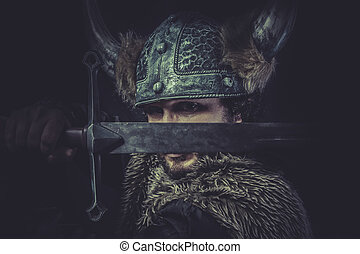 Leadership, Viking warrior with a huge sword and helmet with...