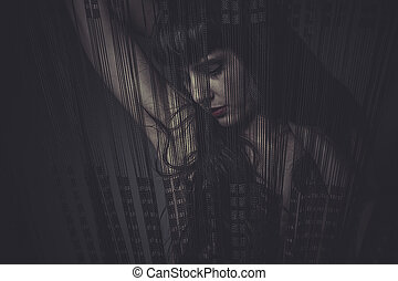 Sensual naked woman behind a curtain of black threads, dream