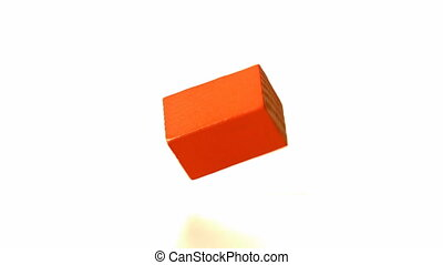 Red building block falling and bouncing in slow motion