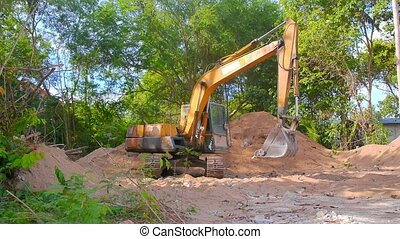 Excavator Working - Extracting and loading gravel excavated