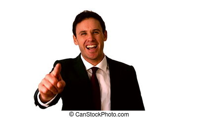 Happy businessman laughing and pointing to camera in slow...
