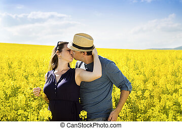 Pregnant couple - Spring outdoor portrait of young pregnant...