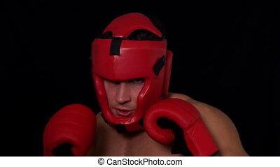 Tough boxer punching with red glov - Tough boxer punching...