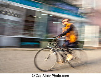Cyclist in traffic on the city roadway. Intentional motion...
