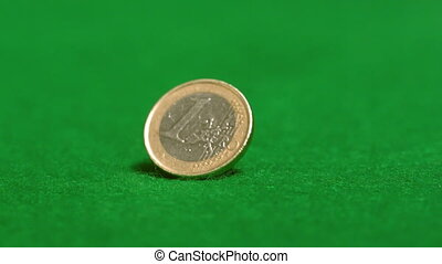 Euro coin spinning on casino table