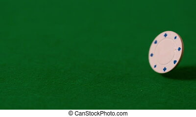 Casino chip falling on green table - Casino chip falling on...