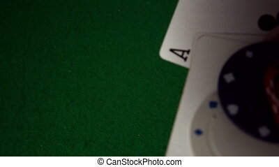 Cards chips and dice falling on casino table in slow motion