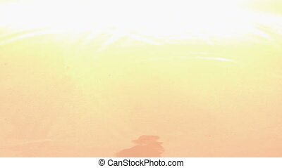 Apple pieces falling and bouncing on white wet surface in...