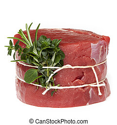 Raw Beef Steak with Herbs Isolated
