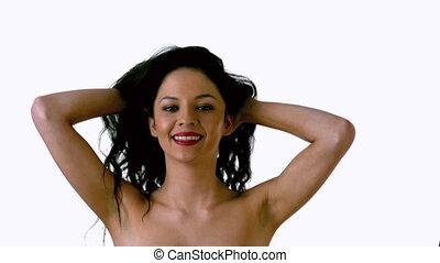 Beautiful brunette shaking her hai