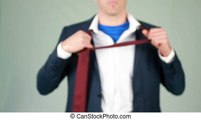 Businessman opening shirt in super - Businessman opening...