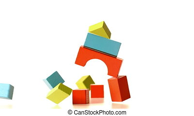 Structure made of building blocks knocking over in slow...