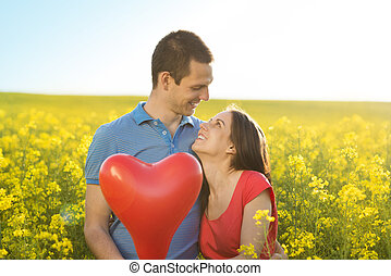 Couple in love in field - Happy young couple in love with...
