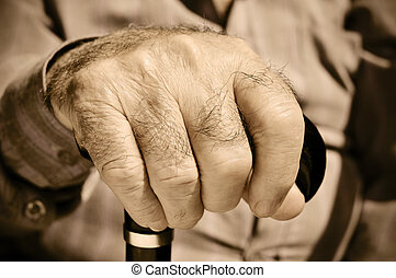 old man - closeup of the hand of an old man with a walking...
