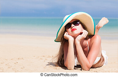 portrait of young beautiful woman on beach with red lips and...