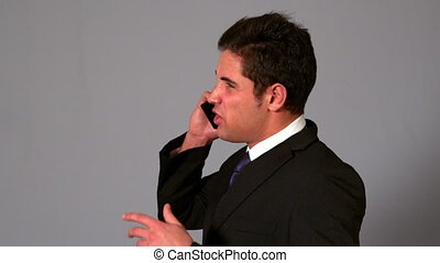 Angry businessman shouting on the phone in slow motion