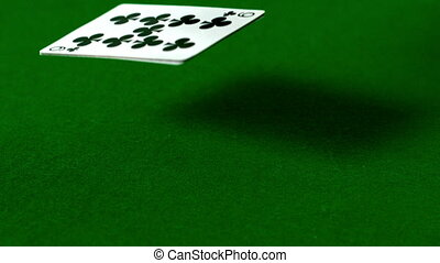 Deck of cards falling on casino table in slow motion