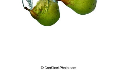 Pears plunging into water on white background in slow motion
