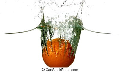 Orange plunging into water on white background in slow...