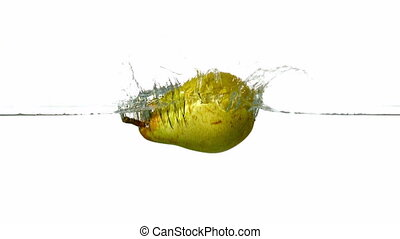 Pear plunging into water - Pear plunging into water on white...