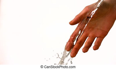 Water pouring over female hand