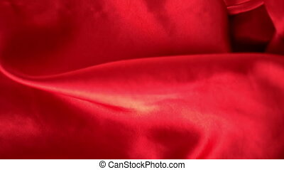 Red silk rippling in the wind in slow motion